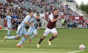 Shane O'Neill races for the ball against Sporting KC. Photo by Marko Babiak.